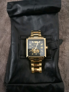 Micheal Hill gold watch