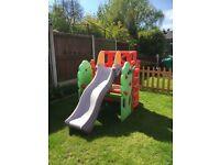 Children's climbing frame and slide