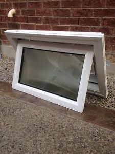 AWNING WINDOW WITH BRICKMOULDING