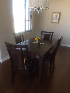 dining room table, 4 chairs, table can get bigger