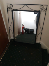 Large black iron mirror