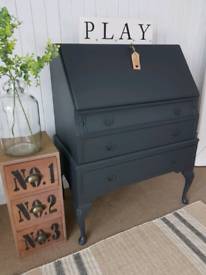 Stylish vintage bureau, classic writing desk, home office with drawers