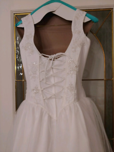 Classic and elegant white wedding dress with corset back