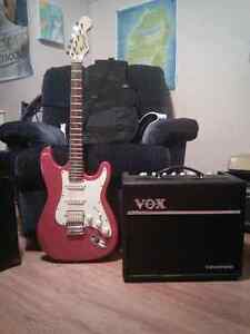 Stage guitar and vox amp