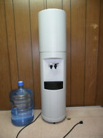 Water cooler with 1 bottle of water (has manual)
