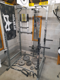 Multi gym, cable machine, squat rack, full Olympic weights with bars.