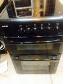 Beko 60cm wide electric cooker glass top with a warranty
