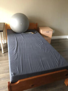 single bed mattress and wood bed frame