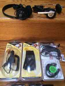 Assortment of cell phone cables , chargers etc