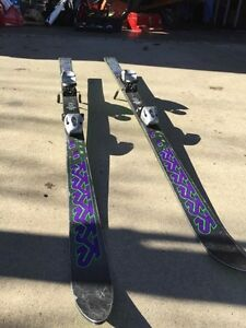 Racing skis with size 24 salomon boots
