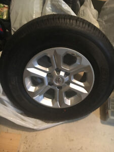 "Tires Bridgestone 17"" and Toyota rims"