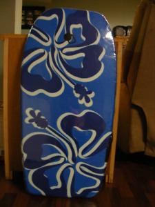 Wave Rider body board. Never used; still in plastic.