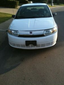 2004 Saturn white  ION Sedan