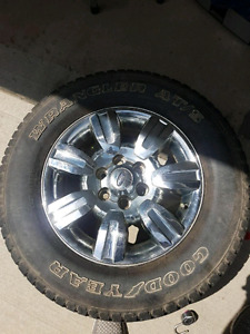 4 Ford F150 factory rims and tires