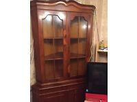 Dark brown wooden corner cabinet
