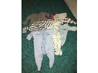 Bundle of first size newborn baby boys sleep suits & vests from Next
