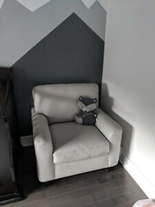 Two condo sized light grey leather loveseats and a chair
