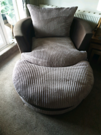 Large swivel chair with half moon footstool