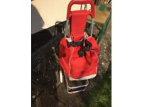 Red collapsible shopping trolley