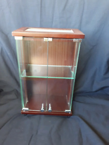 Curio Cabinet with glass doors and shelf