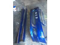 Corsa c irmsher bumper with grill and side skirts