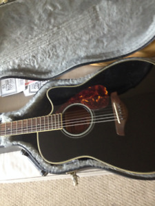 Yamaha Acoustic/Electric Guitar with Case and Strings