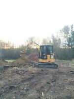 Landscaping , excavating , bobcat services