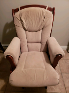 Beige glider with foot rest