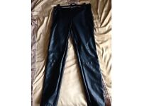 Next leather look (PVC) trousers