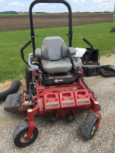 Commercial EXMark zero turn Mower and accessory package