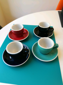 4 New espresso cups and saucers.