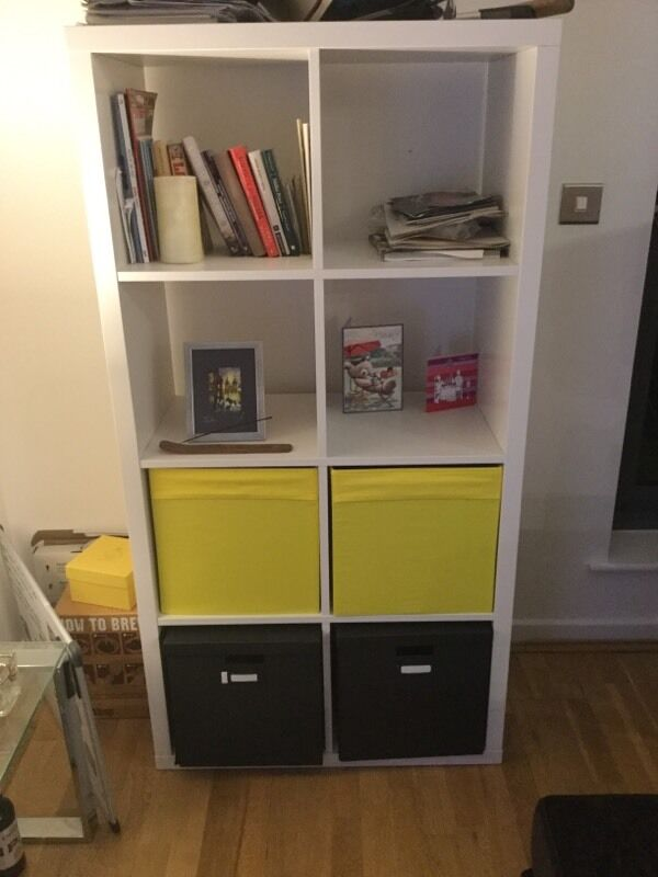 IKEA shelving unit with 4 storage boxes