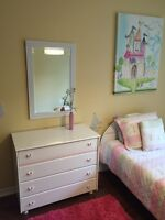 Solid wood girls dresser and bed-frame. Solid condition.