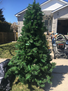 7 ft tall artificial Christmas tree with ornament