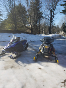 Two snowmobiles and trailer