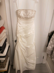 Wedding Dress Size 12 fits closer to a size 10 regular clothing