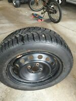 4 winter tires with rims 185/60R15 84s Tiger Paw