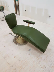 Old fashioned dentist chair for tattoo shop