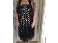 Size 14 black & silver sequinned dress.