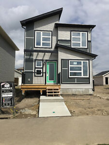 SPRUCE GROVE MODERN HOME OUTSIDE AND IN-MUST SEE