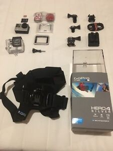 GoPro 4 silver the touchscreen one with accessories and card