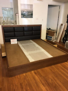 compact Modern king sized storage bed in walnut stain large drwr