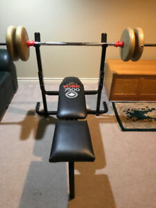 York 7500 bench press and 100 pounds of weights plus bar