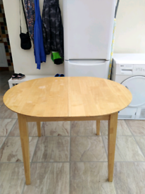 Small extendable dining table and 2 chairs.