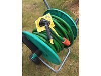 Approximately 100 feet hose and wheeled cart