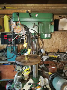 Drill press,saw and grinder.