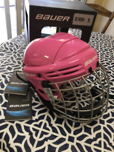Bauer Hockey helmet pink with cage . Mint condition