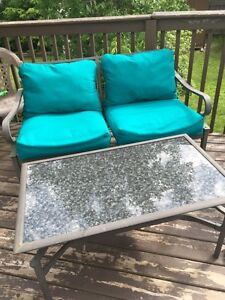 4 piece patio furniture set.  Brand new cushions / table .