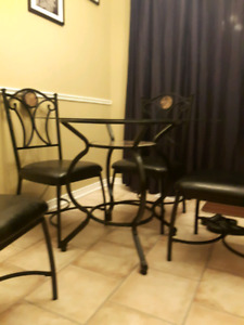 Black Iron and Glass Top Table and 4 Chairs