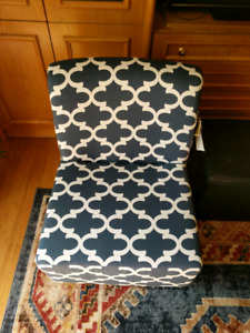 Blue and white floral fabric chair